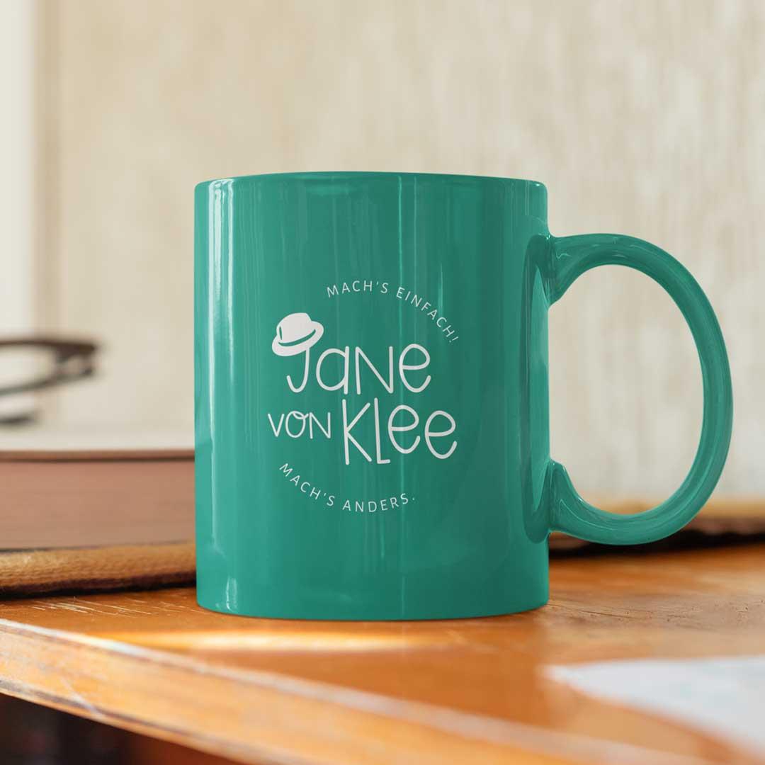 Jane von Klee grüne Tasse mit Logo